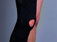 Orteza stawu kolanowego zszynami wyciągana zapinana krzyżowo 45cm
